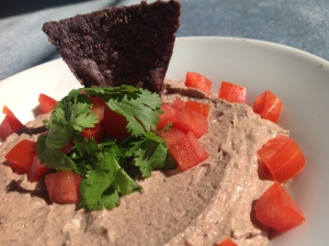 As a dip, black bean green chile hummus pairs brilliantly with tomatoes, cilantro and blue corn chips.