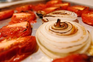 Cut your tomatoes in half and your onions in thick rings, roast them and then char them under the broiler.